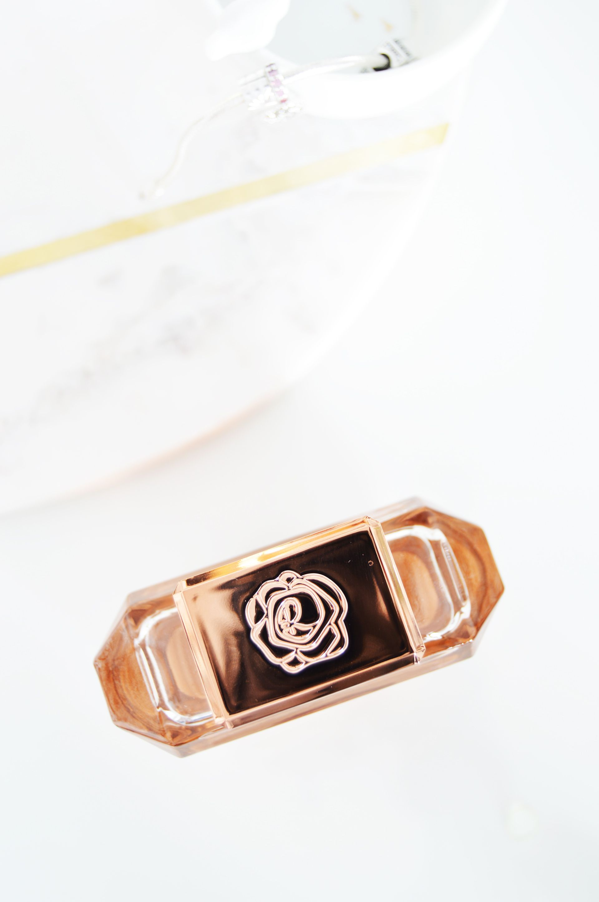 """Rosie for Autograph Rose Gold is described as """"Elegant, airy bergamot and soft spices are wrapped in smooth, floral bouquet notes..."""" and it smells as good as it's described. It is elegant, it is soft and it is refreshing. 